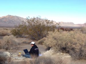 Amargosa Conservancy hydrogeologist Andy Zdon checking well depth at our Twelvemile Spring well in Chicago Valley.